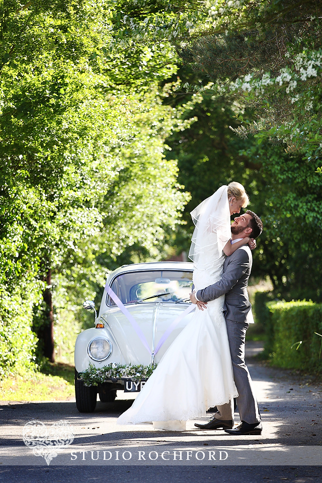Bride and Groom with VW Beetle Wedding Car