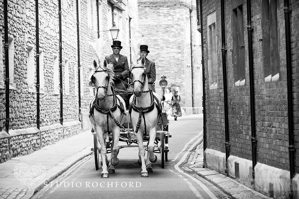 Osteller Horse drawn wedding carriage arriving at Trinity Hall Cambridge