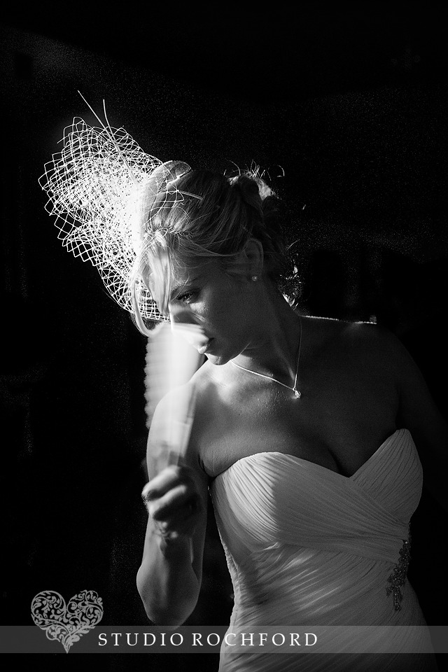 Bride with fan wedding photography cambridge