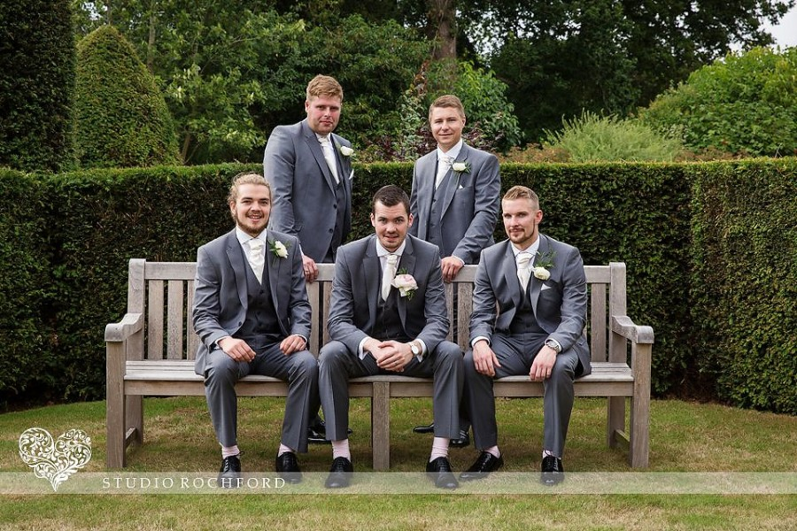 Grooms party in gardens at Blake Hall Ongar